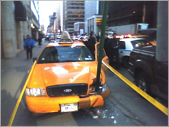 Manhattan cab on sidewalk.