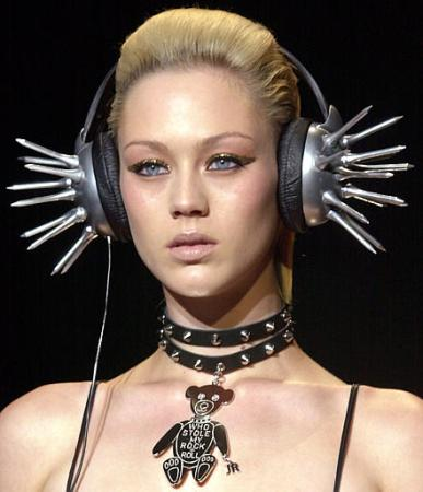 A model wears futuristic headphones at part of the John Richmond Spring-Summer 2003 fashion collection presented in Milan, Italy, Tuesday, Oct. 1, 2002. (AP Photo/Antonio Calanni)